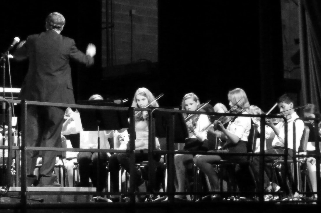 Keith Hedin conducting the NMS Orchestra at a concert.